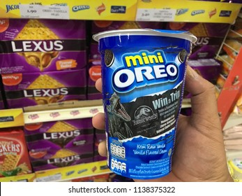 Kuantan, Malaysia - July 20, 2018: Hand Holding, Mini Oreo in the supermarket. Oreo is a sandwich cookie consisting of two chocolate wafers with a sweet creme filling in between.