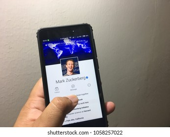 KUANTAN, MALAYSIA - MARCH 28, 2018 : Hand holding smartphone using facebook apps