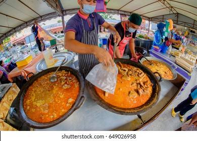 Kuantan, Malaysia - May 28, 2017: Variety of Malaysian food sold at the  Ramadhan Bazaar in Kuantan, Malaysia. The bazaar  is a famous market offering varied Malay  food for iftar or buka puasa.