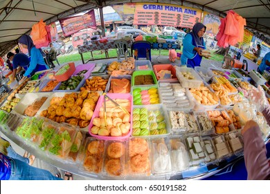 Kuantan, Malaysia - May 28, 2017: Variety of Malaysian food sold at the  Ramadhan Bazaar in Kuantan, Malaysia. The bazaar  is a famous market offering varied Malay  food for iftar or buka puasa.