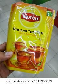 Kuantan, Malaysia - October, 2018: Hand holding Lipton product.