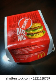 Kuantan, Malaysia - October, 2018: Top view of the new McDonald's burger, Mega Mac or Double Big Mac in the packaging on the table.