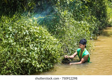 "Kuantan, Malaysia - October 21st, 2017 : Portrait of Malay man wearing the traditional malay fisherman costume catches fish for food on  Sungai Pandan river during Photo Outing ""Senandung Anok Pahang"