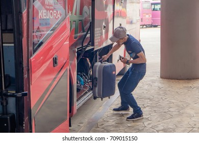 Kuantan, Malaysia - September 3rd, 2017 :  The passenger inserts the suitcase into the luggage compartment on the Maju Ekspress bus  at Terminal Sentral Kuantan.Malaysia