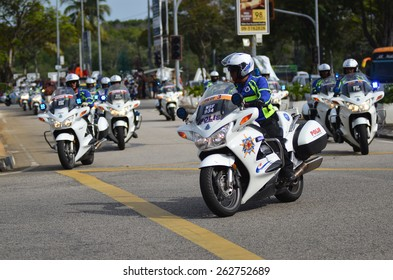 KUANTAN - MARCH 12: a group of policeman in action during stage five of the 2015 Le Tour de Langkawi (LTdL) on March 12, 2015 in Kuantan, Pahang, Malaysia.