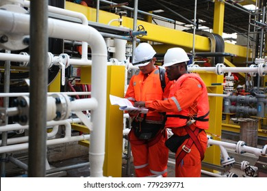 Kuantan, Pahang - Circa 2015: Workers on the oil rig performs routine standard operation procedure health check for daily record.