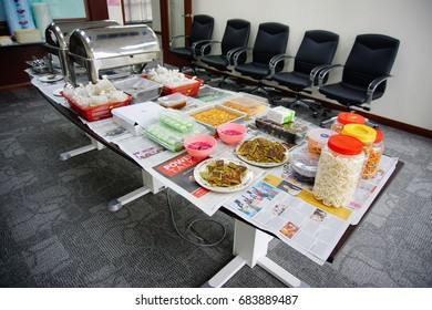 KUANTAN, PAHANG - JULY 2017. Food for mini party has been ready on the office table.