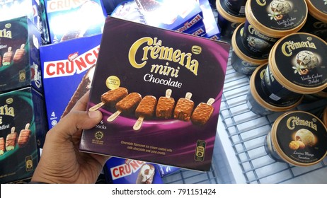 Kuantan Pahang, Malaysia - 3rd January 2018 : Hand hold a box of LA CREMERIA ice cream in the hypermarket.