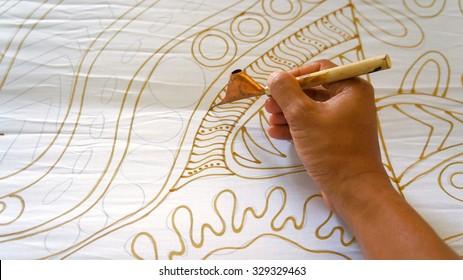 KUANTAN PAHANG, MALAYSIA - OCT 13 2015 : Unidentified local woman sketching freehand with canting tools and hot wax to create a traditional Batik Canting at workshop in Kuantan, Pahang Malaysia
