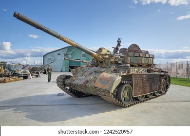 KUBINKA, MOSCOW OBLAST, RUSSIA - AUG 22, 2018: International military-technical forum ARMY-2018. Syrian exhibition. Soviet main battle tank T-55MV, captured from terrorists in Syria