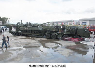 """KUBINKA, MOSCOW OBLAST, RUSSIA - Aug 24, 2017: Russian truck tractor BAZ-6403 with semi-trailer and T-80U tank, in the Park """"Patriot"""", international military-technical forum ARMY-2017"""
