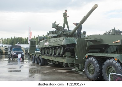 """KUBINKA, MOSCOW OBLAST, RUSSIA - Aug 24, 2017: Russian T-80U tank stands on the semi-trailer of the truck BAZ-6403 in the Park """"Patriot"""", international military-technical forum ARMY-2017, front view"""