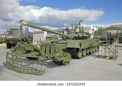"""KUBINKA, MOSCOW OBLAST, RUSSIA - AUG 22, 2018: International military-technical forum ARMY-2018 in military-Patriotic park. The Russian main battle tank T-90 """"Vladimir"""" with mine plow TMT-K"""