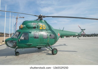 "KUBINKA, MOSCOW REGION, RUSSIA - April 13, 2016: Russian military helicopter Mi-2 Hoplite in the military Park ""Patriot"", side view"