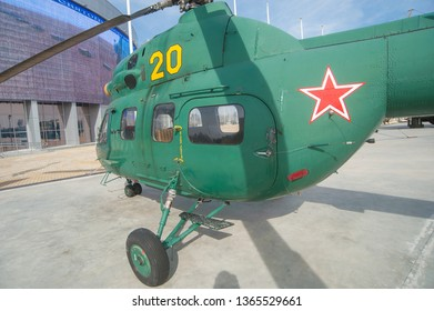 "KUBINKA, MOSCOW REGION, RUSSIA - April 13, 2016: Russian military helicopter Mi-2 Hoplite in the military Park ""Patriot"", rear view of the cockpit"