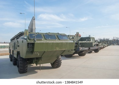 """KUBINKA, MOSCOW REGION, RUSSIA - April 13, 2016: Launcher on a three-axis amphibious vehicle chassis BAZ-5921 Soviet tactical missile system OTR-21 """"Point"""" (9K79) in the Park """"Patriot"""""""