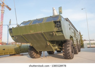 """KUBINKA, MOSCOW REGION, RUSSIA - April 13, 2016: Launcher on a three-axis amphibious vehicle chassis BAZ-5921 Soviet tactical missile system OTR-21 """"Point"""" (9K79) in the Park """"Patriot"""", front view"""