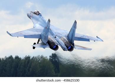 KUBINKA, MOSCOW REGION, RUSSIA - JULY 15, 2016: Sukhoi Su-35S RF-95850 (NATO code name: Flanker-E) multifunctional jet fighter landing at Kubinka air base.