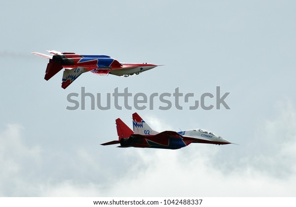 Kubinka, Moscow region, Russia - September 07, 2016. Two Russian MiG-29 (FULCRUM) from aerobaic team STRIZHI in International Military-Technical Forum ARMY-2016.