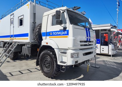 KUBINKA, RUSSIA, AUG.24, 2018: View on Russian police special cars and trucks on Kamaz platforms for different purposes. City police cars of white and blue colors