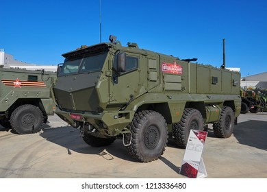 KUBINKA, RUSSIA, AUG.24, 2018: View on heavy military armored 6WD vehicle KAMAZ-63968 Tayfun-K for troopers and different weapon transportation. Multipurpose military trucks on exhibition