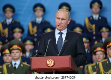 KUBINKA, RUSSIA - JUN 16, 2015: The President of the Russian Federation Vladimir Putin at the opening ceremony of the International military-technical forum ARMY-2015 in military-Patriotic park