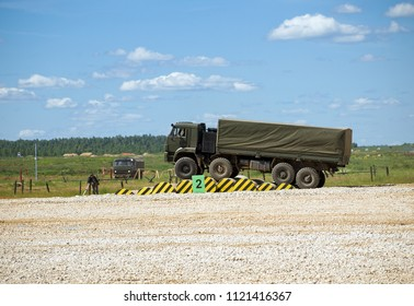 "Kubinka, Russia - June 18, 2015: Military truck ""Kamaz"" on the obstacle. Proving Ground Alabino. International Military-Technical Forum ""Army-2015"", the park ""Patriot"", Moscow region."
