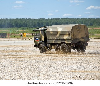 "Kubinka, Russia - June 18, 2015: Military car ""Kamaz"" in a controlled drift. Proving Ground Alabino. International Military-Technical Forum ""Army-2015"", the park ""Patriot"", Moscow region."