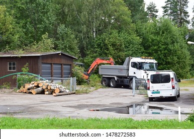 Kubota excavator and dump truck in industrial site and area - workplace - Kongsvinger, Norway (7th august 2019)