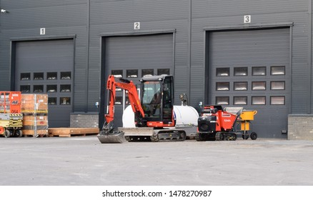 Kubota excavator in industrial site and area - workplace and storage building service - Kongsvinger, Norway (7th august 2019)