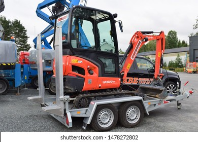 Kubota excavator on trailer in industrial site and area - workplace - Kongsvinger, Norway (7th august 2019)