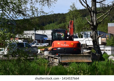 Kubota sign on excavator machine - sunny and summer season - industrial site and area - Kongsvinger, Norway (3th june 2019)