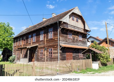 Kuce, Croatia-August 6th, 2021: Old, traditional wooden school in the village of Kuce, on the edge of Turopolje forest, monument of traditional croatian architecture in continental regions