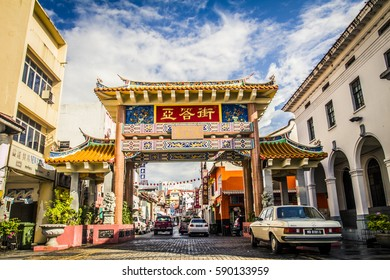 Kuching, Malaysia - 27 November, 2009: Main street of Chinatown with the entrance gate in central Kuching
