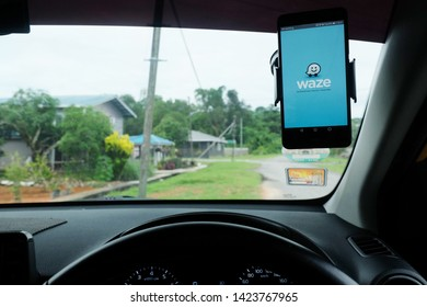 """Kuching, Malaysia- Circa June, 2019: A picture of Waze app in smartphone on phone holder for guiding the driver."""
