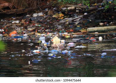 KUCHING, MALAYSIA - CIRCA MAY 2018: Plastic pollution environmental problem. Bottles, bags and other trash dumped in sea