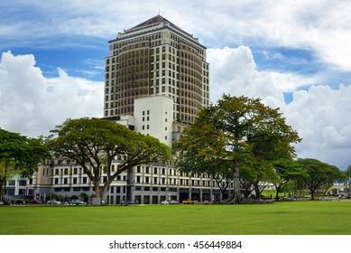 Kuching, Malaysia - Dec 30, 2015: Cotton Silk Tree and Merdeka Palace Hotel on Merdeka Square. Sarawak. Borneo