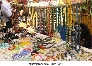 KUCHING, MALAYSIA -DECEMBER 07, 2016: Traditional Malaysian Sarawak ethnic woman accessories. Bracelets and necklaces made from made of special stones and animal skins.