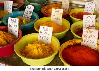 Kuching, Malaysia, January 3, 2019: Brightly cololured fine powdered spices for sale in the Little India area of Kuching, in the state of Sarawak, Malaysia