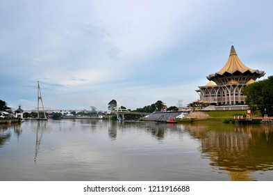 Kuching, Malaysia - October 11, 2018: The distinct architecture of the Sarawak State Legislature Assembly building and the Harmony or Darul Hana footbridge across the Sarawak River.