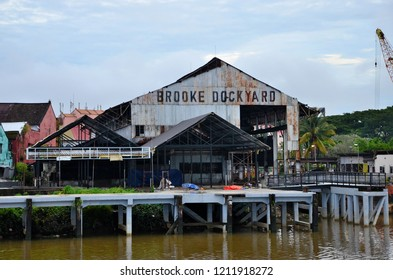 Kuching, Malaysia - October 11, 2018: The historic Brooke Dockyard facility and warehouse on the Sarawak River waterfront. The dockyard was opened in 1912 by the second White Rajah Charles Brooke.