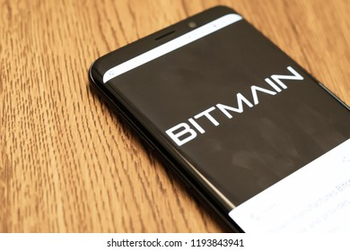 Kuching, Malaysia - October 2, 2018: Bitmain cryptocurrency crypto mining app to mine Bitcoin Ethereum Litecoin and other blockchain currencies. Bitmain application logo on smartphone screen close-up.