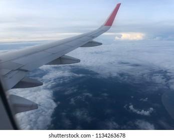 Kuching, Sarawak - 15 April 2018 : View the wing of Air Asia flight and blue sky at Sarawak land area.