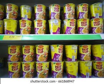 kuching, sarawak - 18 june 2017 : maggi hot cup flaver tomyam kaw on the supermarket shelf display