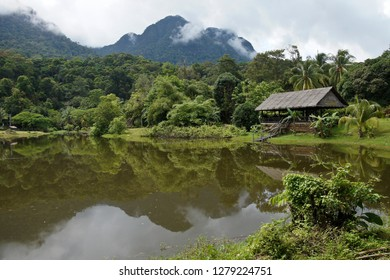 KUCHING, SARAWAK, MALAYSIA — APRIL 19, 2018. Sarawak Cultural Village, at the foot of Mount Santubong, is set around a lake amid a tropical forest and features replica indigenous houses.