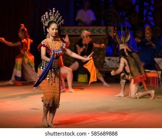 Kuching, Sarawak, Malaysia - Circa November 2013 - Dance performance where professional dancers depict numerous traditional dances at the Sarawak Cultural Village