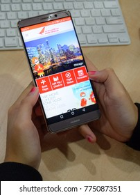 kuching sarawak malaysia dwecember13 2017 : smartphone mobile app online Air India. Concept Image contains excessive noise, film grain, compression artifacts,