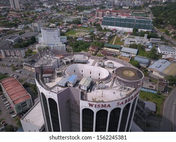 Kuching, Sarawak / Malaysia - November 17 2019: Creative shot - an aerial top down view of a donut shaped building in Kuching, the island of Borneo. The core of the building was empty.