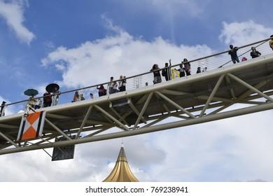 kuching sarawak, malaysia november17 2017 : people enjoying the great view of kuching city and new design bridge of darul hana during sarawak regatta.