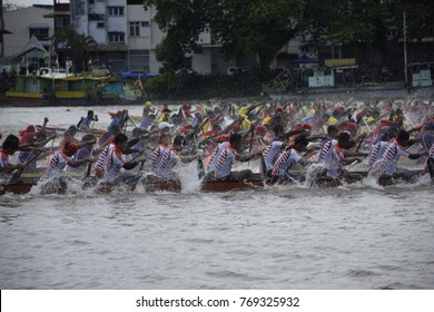 kuching sarawak, malaysia november17 2017 : the paddle boat race with different colours at river during sarawak regatta 2017 at kuching city.